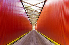 Old red bridge roadway Stock Images