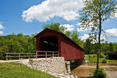 Old Red Bridge by Stone Wall Royalty Free Stock Photo