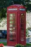 An old red british telephone booth from the front. An old red british telephone booth as seen from the front Stock Image