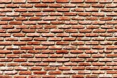 Old red-brown brick wall, old background concept royalty free stock photography