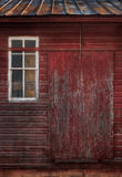 Old Red Building. Worn side of red building, window and door Stock Photo