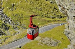 Old red cable car in the mountains Stock Photography