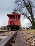 Old red caboose with train track Royalty Free Stock Images