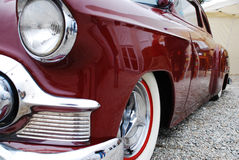 An old red cadillac. From a side fiew Stock Photos