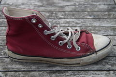Old red canvas shoe Royalty Free Stock Photo