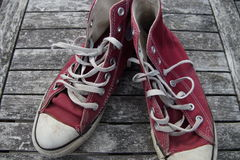 Old red canvas shoes Stock Image