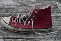 Old red canvas shoes - side Royalty Free Stock Photos