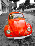 Old red car. An old red car on the street stock image