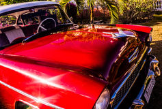 Old red car. Beautiful old Chevy. that is red with a lot of chrome. the seats inside are red and white Stock Image