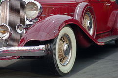 Old red Chrysler. Luxury car. Detail of old red luxury Chrysler car (front and left side&#x29 stock image