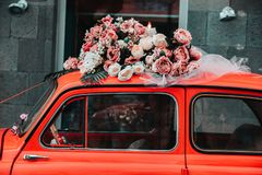 Old red car with flowers stock photo