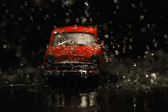 Old red car in rain Royalty Free Stock Photography