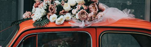 Old red car with a ribbon royalty free stock images
