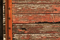 Old red carriage  with peeling  paint grunge  background Stock Photos
