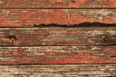 Old red carriage  with peeling  paint grunge  background Royalty Free Stock Photos