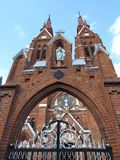 Old red catholic church, Lithuania Stock Images