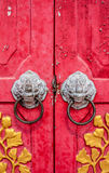 Old red chinese temple door with crave leaf Stock Photo
