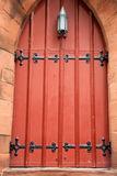 Old red church door with black hardware Royalty Free Stock Photography