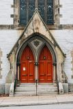 Old red church doors on Eutaw Place, in Baltimore, Maryland.  royalty free stock image
