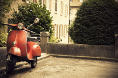 Old Red Classic Scooter. Parked old red scooter, vintage photo Royalty Free Stock Image