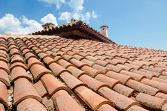 Old red clay roof shingles. Vintage clay roof shingles European style closeup Royalty Free Stock Photos