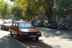 Old red Dacia car on the streets in Bucharest Royalty Free Stock Photos