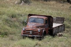Old Red Dodge Truck. With a wooden platform, the truck is parked in a field stock images