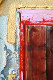 Old red door. Corner with decaying yellow wall royalty free stock photo