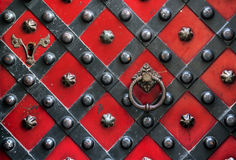 Old red door with handle Royalty Free Stock Images