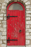Old Red Door. Set in a stone wall Royalty Free Stock Photos