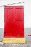 Old Red Door in White and Gray Wall Stock Photography