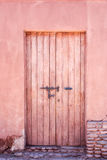 Old red door. Old red wooden door on a red wall Royalty Free Stock Image