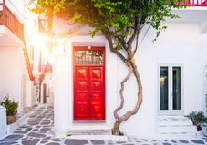 Cityscape of the island Mykonos. Old red doors in old house at island Mykonos Stock Photos