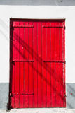 Old Red Doors with Metal Hinges Stock Photography