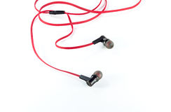 Old red earphones isolated Stock Photos
