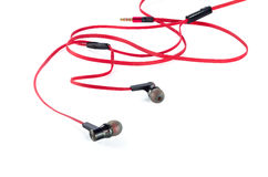 Old red earphones isolated Royalty Free Stock Photo