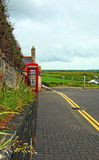 Old Red English Telephone booth at Giants Causeway UNESCO site Stock Photos