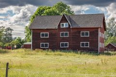 Old red farm house and dramatic sky stock images