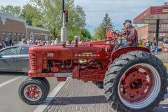 Old Red Farmall tractor in Pella, Iowa. Old red Farmall tractor photographed in Pella, Iowa during 2015 Tulip Festival Stock Photo