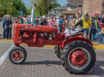 Old Red Farmall tractor in Pella, Iowa. Old red Farmall tractor photographed in Pella, Iowa during 2015 Tulip Festival Royalty Free Stock Photo