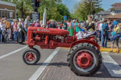 Old Red Farmall tractor in Pella, Iowa. Old red Farmall tractor photographed in Pella, Iowa during 2015 Tulip Festival Stock Images