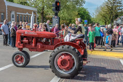 Old Red Farmall tractor in Pella, Iowa. Old red Farmall tractor photographed in Pella, Iowa during 2015 Tulip Festival Royalty Free Stock Photos