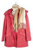 Old red female jacket hangs on a hanger Royalty Free Stock Images
