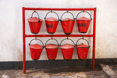 Old red fire buckets Stock Images