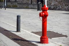 Old red fire hydrant in New York City street. Fire hidrant for emergency fire access Royalty Free Stock Photos