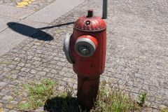 Old red fire hydrant in the street, Vila do Conde, Porto region, Portugal. royalty free stock image
