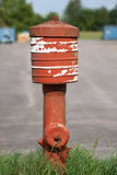 Old red fire hydrant Royalty Free Stock Photo