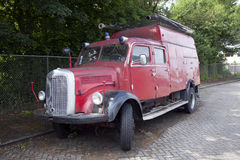 Old red fire truck parked in the netherlands Royalty Free Stock Photo