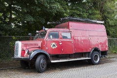 Old red fire truck parked in the netherlands Stock Photography