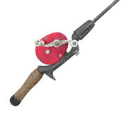 Old red fishing reel on rod isolated Stock Photography
